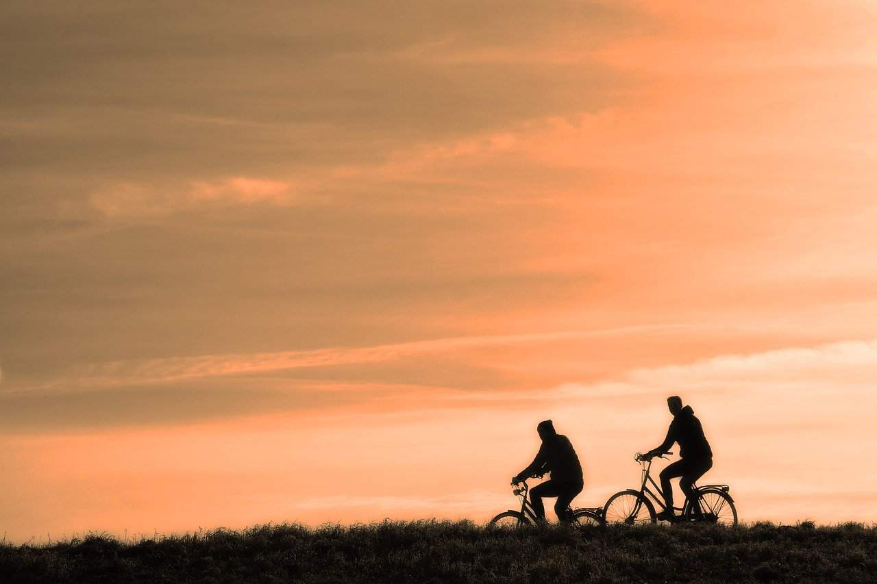 cyclists at the sunset_cycling with family